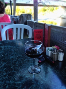 Great river-view patio. Worst wine glass ever.